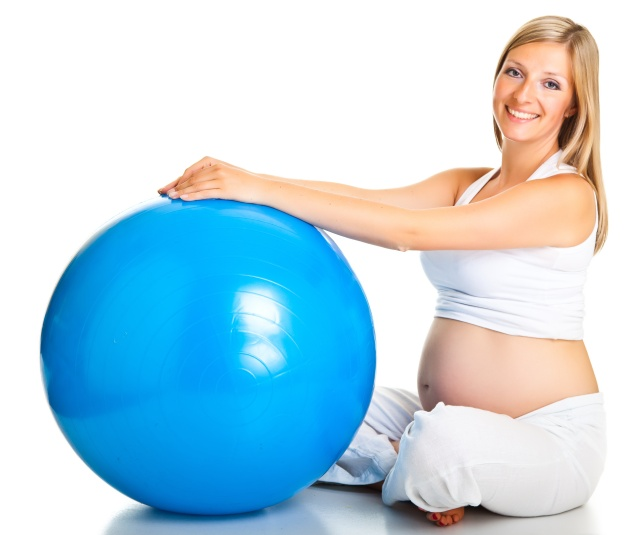 Pregnant woman excercises with gymnastic ball
